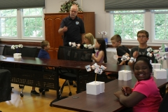 Rick helps kids build wind speed sensor models using Dixie cups