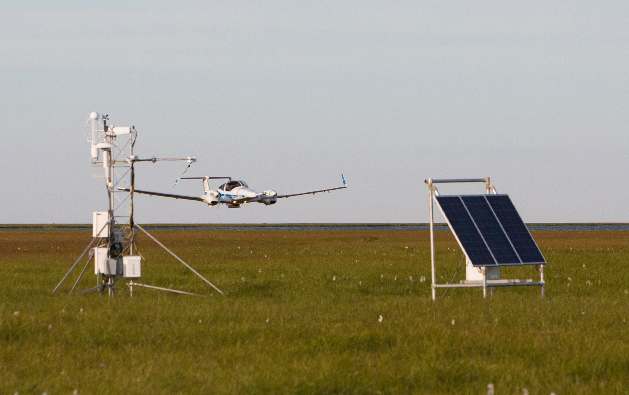 DA-42 performing low-level measurements near the ground-based flux tower
