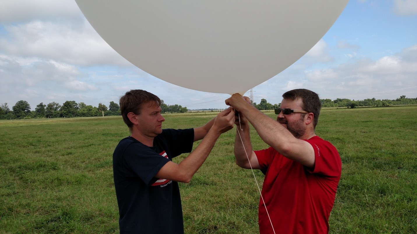 ATDD researchers prepare a weather balloon for launch