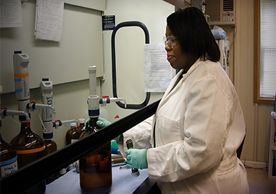 Dr. Myles preparing a sampling tube