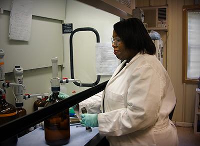 Dr. Myles preparing for a lab test