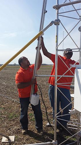 Interns installing ammonia sensors