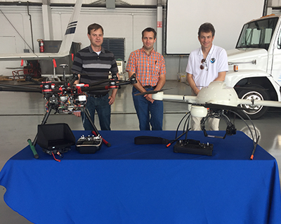 photo of Michael Buban (left), Temple Lee (center), Ed Dumas (right) with unmanned aircraft systems