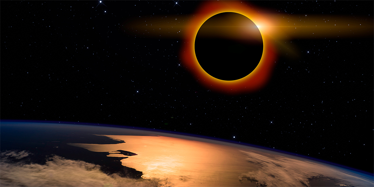 Image of solar eclipse from space with Earth in foreground