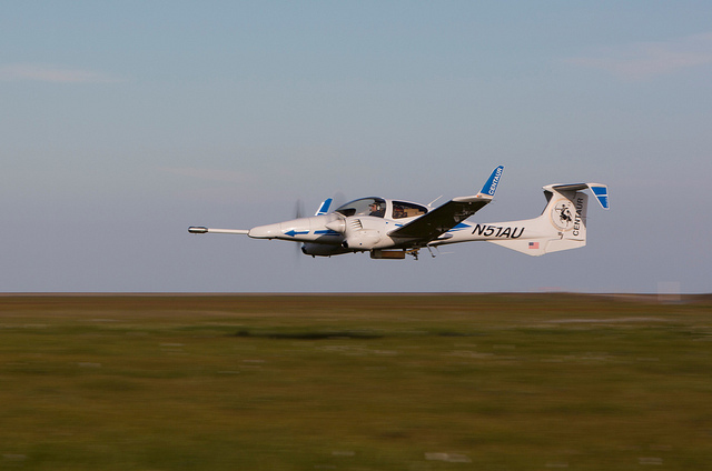 Centaur aircraft flying low over Alaska tundra