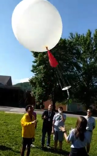 Students, teachers watch balloon launch