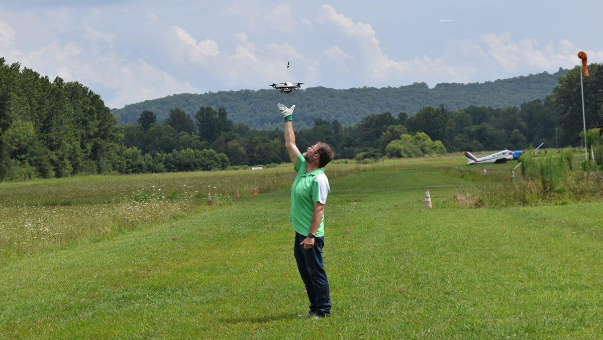 Tom prepares to catch drone